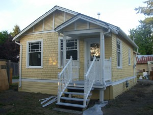 The little yellow house with its new porch and paint.