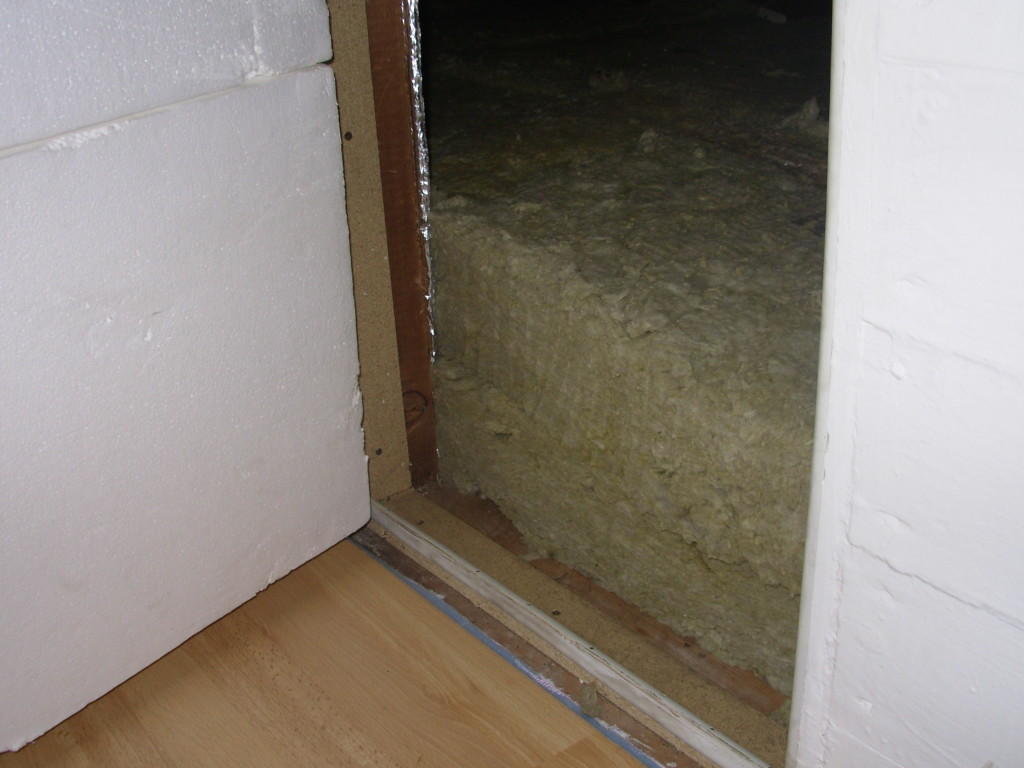 A nice deep blanket on the other side of the attic door
