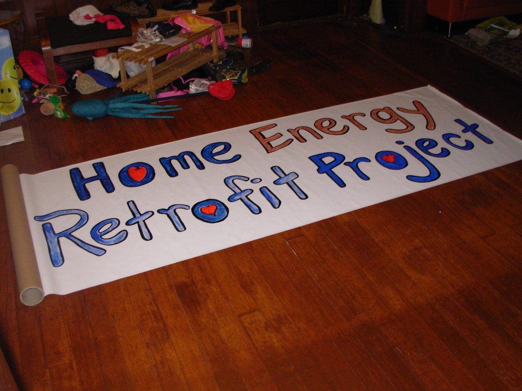 The sign I painted for Earth Day on the living room floor