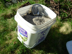 A bucket o' ash. We don't use that cat litter anymore, it's not compostable