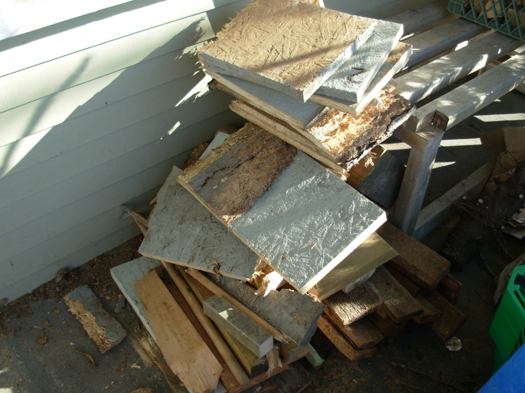 This is fibreboard from my parents old back deck--complete with rubbery coating. Sorry neighbours!