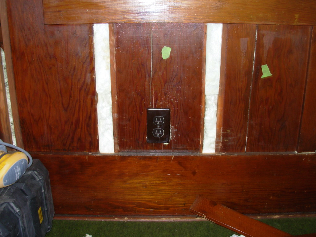 The blown-in foam insulation shows when the slats are removed. We put green tape on cracked wall boards.