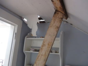 Someone put their foot through the ceiling. Oh well, that ceiling will be rebuilt anyway. I hope they were okay!