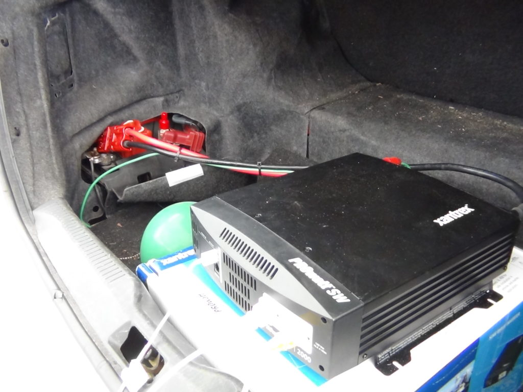 Plug stuff into the inverter (front) which draws power from the auxiliary battery (rear)
